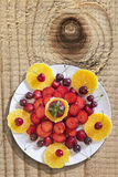 Plateful Of Spring Fruits On Old Wooden Knotted Table Surface Stock Photos