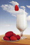Plateful Of Strawberries With Glass Of Milk Royalty Free Stock Photography