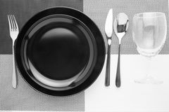 Platein table knife and fork spoon on napery Royalty Free Stock Photo