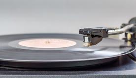 Platenspelermelodie op een roterende schijf Royalty-vrije Stock Afbeelding