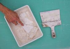 Platering hjälpmedel för murbruk som plastemurslevspateln royaltyfri bild