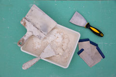 Platering tools for plaster like plaste trowel spatula. On green drywall plasterboard Stock Image