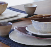 Plates. Bowls and toothpicks of ceramics prepared to eat Royalty Free Stock Images