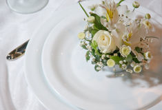 Plates. Decorated with a bouquet of flowers Royalty Free Stock Photos