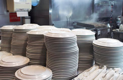 Plates. A stack of plates in a restaurant Royalty Free Stock Images
