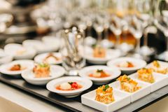 Plates with appetizers on some festive event. Party or wedding reception royalty free stock photo