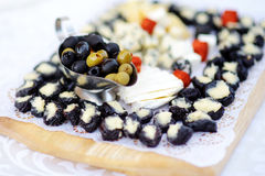 Plates with assorted finger food snacks on an event party or dinner Royalty Free Stock Images