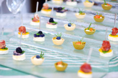 Plates with assorted finger food snacks on an event party or dinner Royalty Free Stock Photos