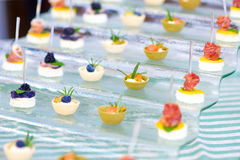 Plates with assorted finger food snacks on an event party or dinner Stock Photography