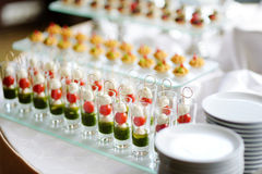 Plates with assorted snacks on an event party Stock Image