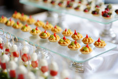 Plates with assorted snacks on an event party Stock Images