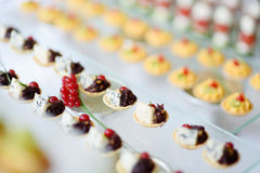 Plates with assorted snacks on an event party Stock Photography