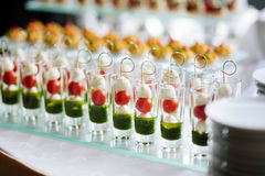 Plates with assorted snacks on an event party Stock Photos