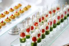 Plates with assorted snacks on an event party Royalty Free Stock Photography