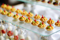 Plates with assorted snacks on an event party Royalty Free Stock Photo