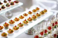 Plates with assorted snacks on an event party Royalty Free Stock Images