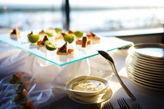 Plates with assorted snacks on an event party Royalty Free Stock Image
