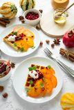 Plates of Belgian waffles with persimmon, pomegranate seeds and sour cream stock photos