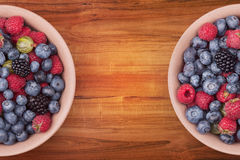 Plates with berries Stock Image