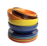 Multi-colored ware. Plates and bowls from ceramics. Side view. It is isolated on a white background Stock Photos