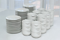 Plates and bowls, white ceramic on a white tablecloth Royalty Free Stock Image