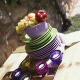 Plates, candles & fruit Stock Photos