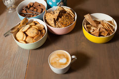 Plates with cookies and cuo on table Royalty Free Stock Photography
