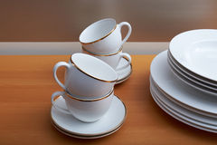 Plates, cups and saucers stock images