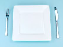 Plates and Cutlery Royalty Free Stock Image