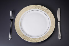 Plates and cutlery Royalty Free Stock Photos
