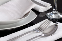 Plates and cutlery served at the table. Horizontal shot Royalty Free Stock Images