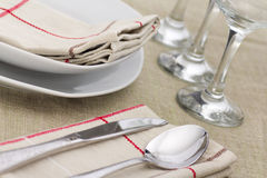 Plates and cutlery served at the table. Horizontal shot Stock Photography