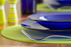 Plates and cutlery on the table Stock Images