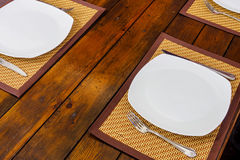 Plates and cutlery on table Royalty Free Stock Photos