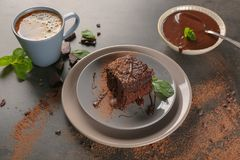 Plates with delicious cocoa brownie. On table Stock Images