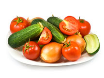 Plates with different vegetables Stock Photos