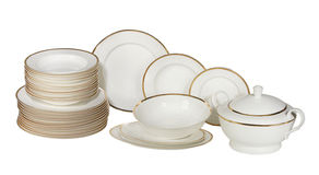Plates and dishes. Set of fresh washed plates and dishes isolated on white Stock Photo