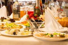 Plates of eats and appetizers on a buffet table Stock Image