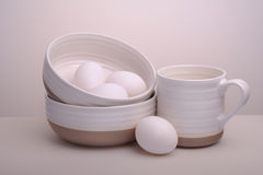 Plates with eggs and mug. stock photos