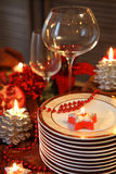 Plates and empty glasses on the Chistmas table Stock Photography