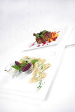 Plates of fine dining meal. Niceley decorated fine dining meals Stock Photos