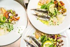 Plates of fish salad appetizers stock photos