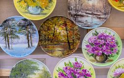 Plates with floral drawings in a street shop royalty free stock photography