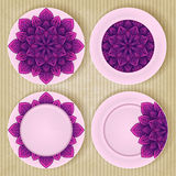 Plates with floral pattern set on retro background Stock Photo