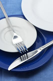 Plates, fork and knife Stock Image