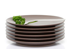 Plates, fork and parsley Royalty Free Stock Photos