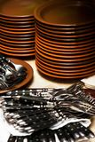Plates and forks Stock Images