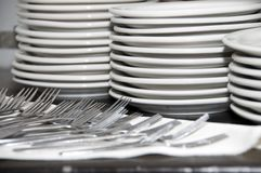 Plates and forks Royalty Free Stock Image