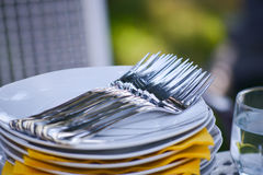 Plates and forks Royalty Free Stock Photo