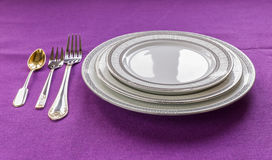 Plates and forks on the table Royalty Free Stock Photo